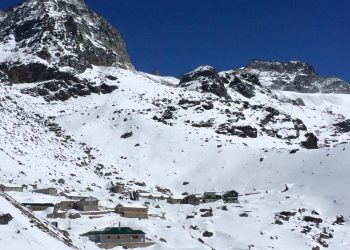 Village covered in snow below Mera Peak