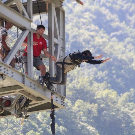 Man jumping for bungee jumping tower in Pokhara, Nepal
