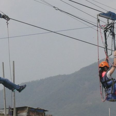 Two people in zip flyer in Sarangkot, Pokhara, Nepal