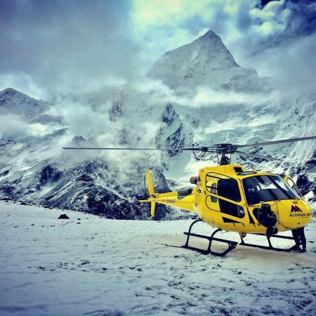 Yellow helicopter in snowy Everest Base Camp