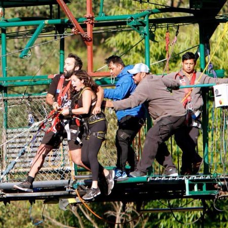 Couple being pushed from bridge for bungee jumping in Bhote Koshi
