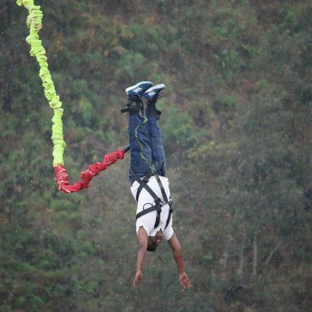 Man mid-air during bungee jumping in Hemja, Pokhara, Nepal