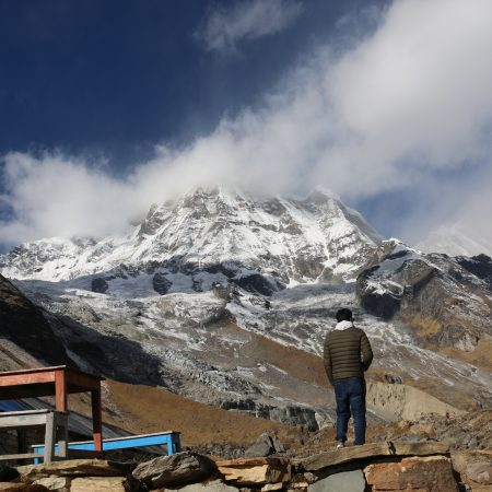 Person in Tea house in rocky terrain of Annapurna