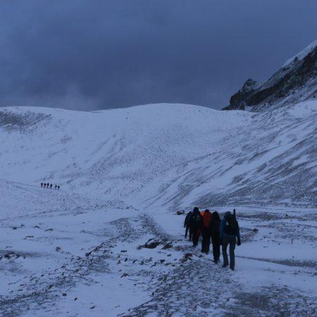Group of trekkers walking in dark in Annapurna Circuit