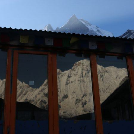 Reflection of Annapurna in a lodge in Annapurna Base Camp