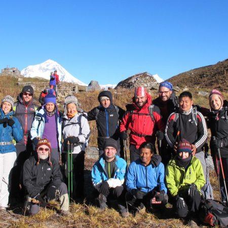 Group of trekkers in Khopra ridge with Dhaulagiri in background
