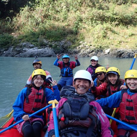 Rafter posing for photo during White Water Rafting in Lower Seti River